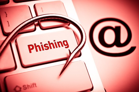 data theft: phishing  a fish hook on computer keyboard with email sign  computer crime  data theft  cyber crime Stock Photo