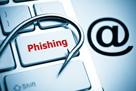 cyber crime: phishing  a fish hook on computer keyboard with email sign  computer crime  data theft  cyber crime Stock Photo