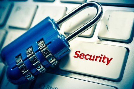 code lock: metal security lock with password on computer keyboard - security concept in computer Stock Photo