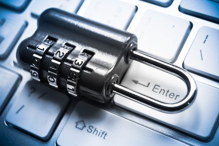 cybercrime: metal security lock with password on computer keyboard - security concept in computer Stock Photo