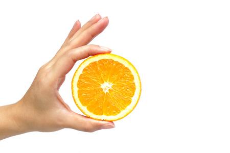 navel orange: hand holding orange Stock Photo