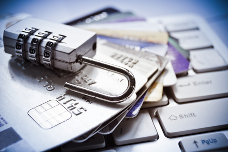 open security lock on credit cards with computer keyboard - credit card data theft