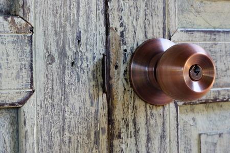door knob: door knob on wooden door
