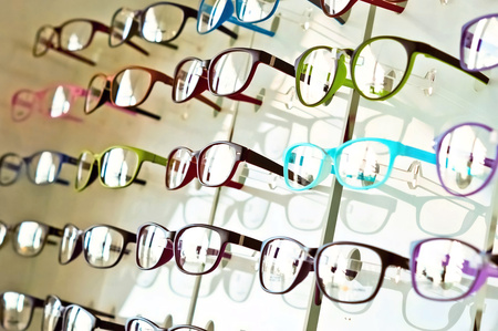wearing spectacles: eye glasses on the shelf