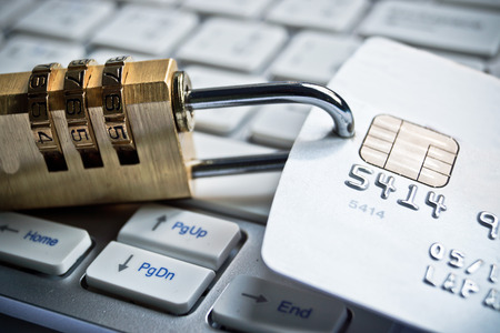 internet fraud: security lock on credit cards with computer keyboard
