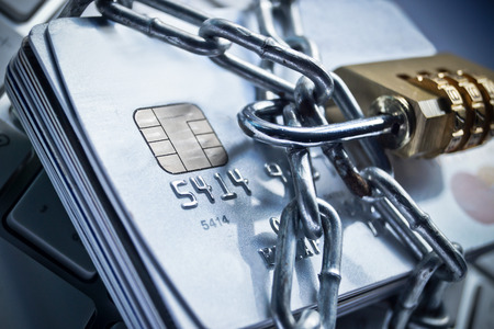 phishing: chained credit cards security lock with password - phishing protection concept