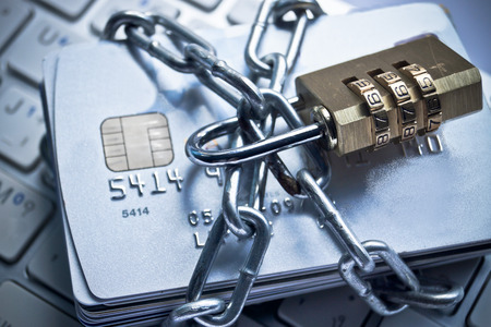 credit risk: chained credit cards security lock with password - phishing protection concept
