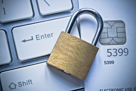 internet safety: security lock on credit cards with computer keyboard - credit card data security