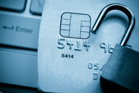 security lock on credit cards with computer keyboard - credit card data security