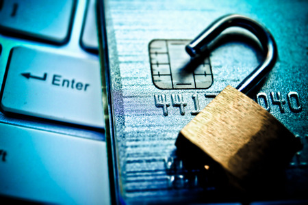 security safety: security lock on credit cards with computer keyboard - credit card data security