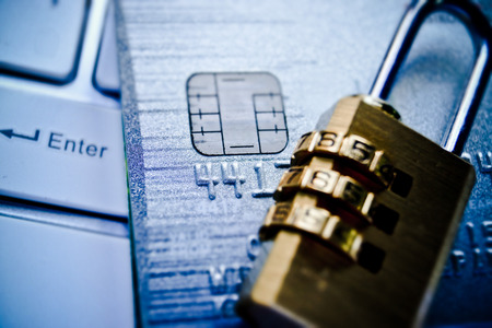 security lock on credit cards with computer keyboard - credit card data security photo