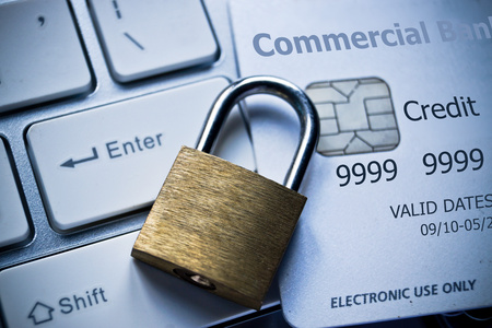 data theft: security lock on credit cards with computer keyboard  credit card data theft protection Stock Photo