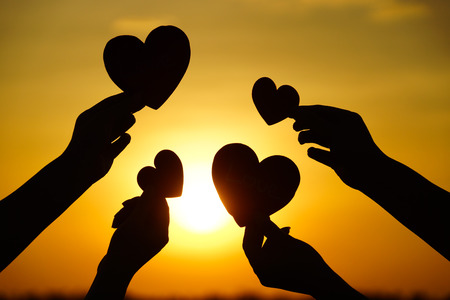 charity  symbol: hands holding hearts silhouette