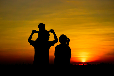 father and son holding hands: family silhouette