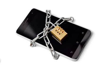 chained: a chained smartphone Stock Photo