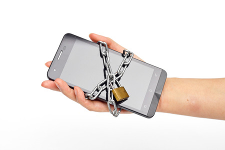 hand holding a chained smartphone
