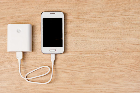 power symbol: smartphone with a power bank