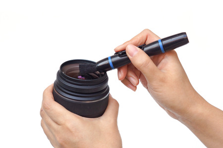 cleaning camera lens with lens pen photo