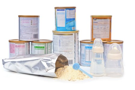 powder milk for the baby with different brands of powder milk background