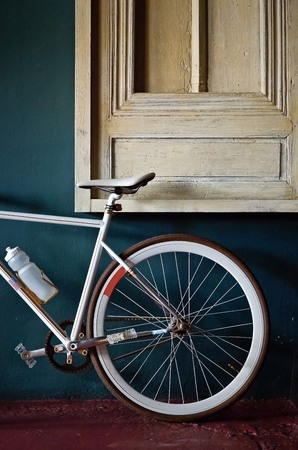 rear wheel: Rear wheel of a fixed gear bicycle background Stock Photo