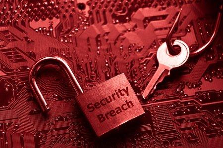 security breach: unlock security lock on computer circuit board - computer security breach concept Stock Photo