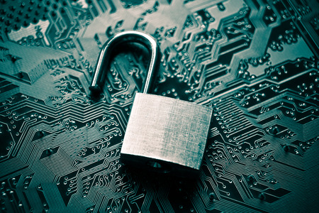 hacked: unlock security lock on computer circuit board - computer security breach concept Stock Photo