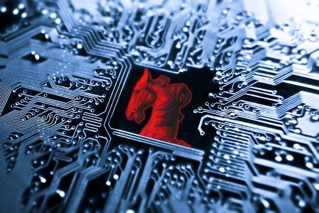 trojan horse: Trojan horse  symbol of a red trojan horse on blue computer circuit board background Stock Photo