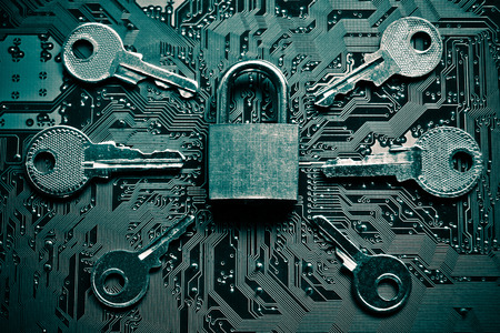 security breach: a security lock on a computer circuit board surrounded by keys  random password hacking concept