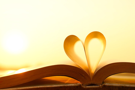 composition book: Heart from book pages with warm sunlight Stock Photo