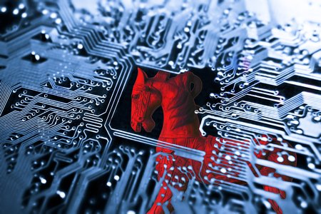 malicious software: Trojan horse  symbol of a red trojan horse on blue computer circuit board background Stock Photo