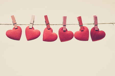 valentine heart: Red hearts hung together on the rope with isolated background