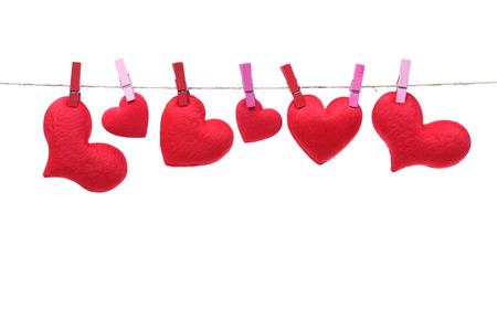 string together: Red hearts hung together on the rope with isolated background