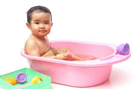 take a bath: take a bath for a young asian baby toys