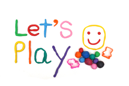 playdoh: clay for children on isolated background saying lets play Stock Photo