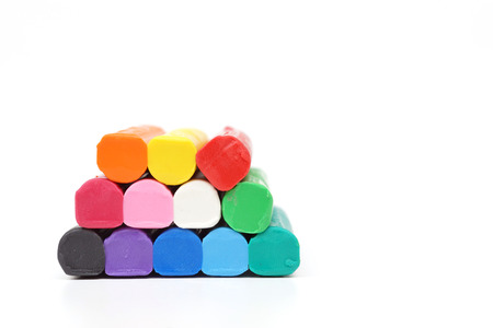 playdoh: colorful clay for children on isolated background Stock Photo