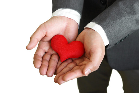 Businessman giving a red heart to a customer on isolated background - sincere service - service mind