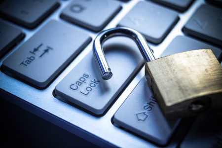 open security lock on computer keyboard - computer security breach concept