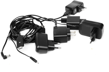 wire mess: Different types of adapter charger on isolated background