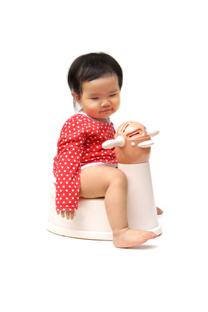 piddle: Asian child on potty play - learning to use toilet