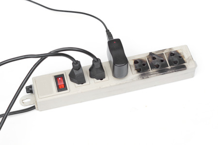 protector: Surge protector caught on fire due to overheat Stock Photo