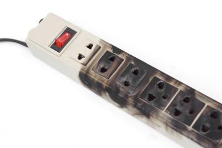 surge: Surge protector caught on fire due to overheat Stock Photo