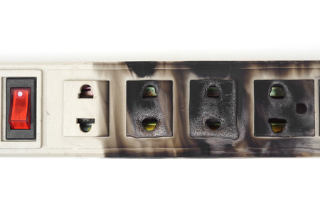 the surge: Surge protector caught on fire due to overheat Stock Photo
