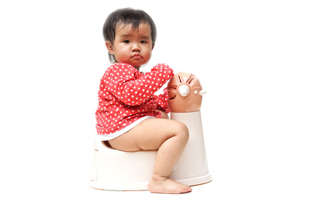 piddle: asian baby using and playing with toilet