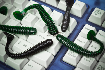 computer worm attacking computer system by penetrating a computer button on a keyboard - worm infection