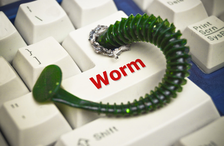 penetrating: computer worm attacking computer system by penetrating a computer button on a keyboard - worm infection