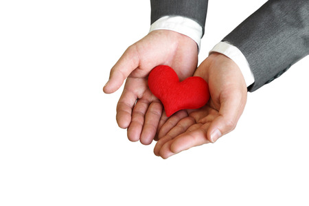 sincere: Businessman giving a red heart to a customer on isolated background - sincere service - service mind