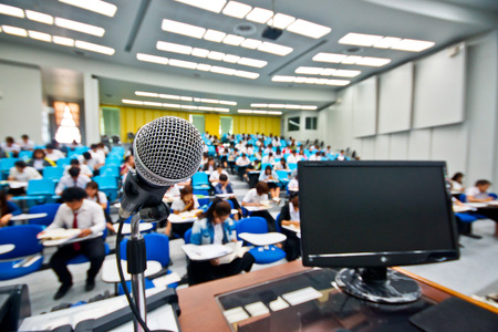 auditorium: A microphone with blur background of many students learning