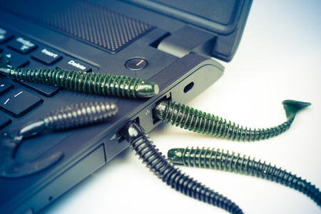 penetrating: computer worm attacking computer system by penetrating a computer through a lan and usb slot Stock Photo