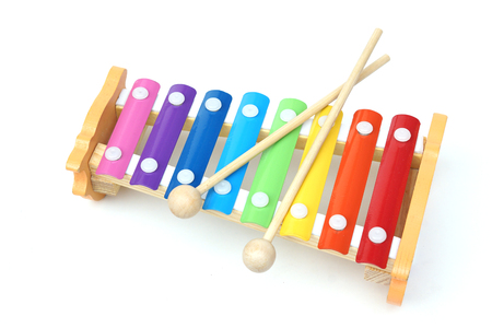 triangle musical instrument: small music xylophone baby percussion instrument Stock Photo