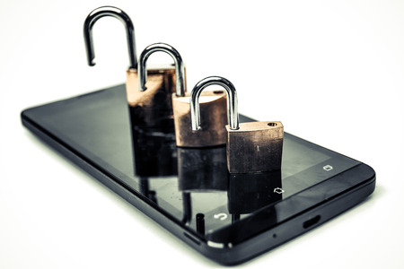 breach: smartphone security breach Stock Photo